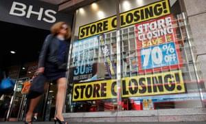 Pedestrians walk past a BHS store in London, Britain July 25, 2016