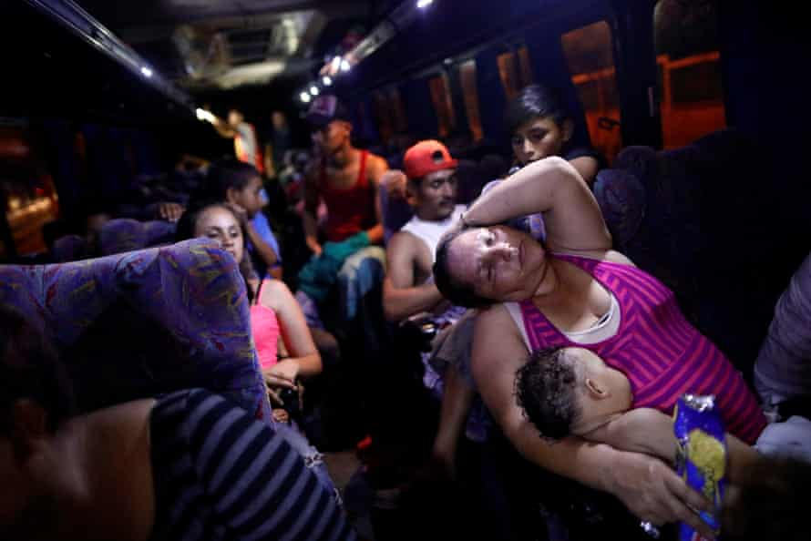 Central American migrants sleep while riding aboard a bus bound for Puebla, in Matias Romero, 5 April