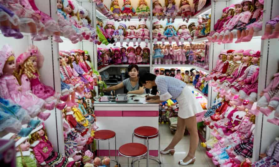Stallholders in Yiwu International Trade City, where more than 400,000 products are on sale.