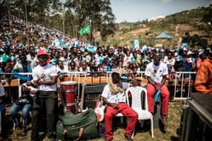 Gakenke, RwandaA musician uses a cymbal to shield from the scorching sun