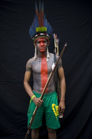 Tawa Chirando, 17, poses for a portrait during a meeting of the Tembe tribes in the Tekohaw village, in the Alto Rio Guama Indigenous Reserve, in Brazil's Para state. Tembe hunt with bows and arrows, fish for piranhas and gather wild plants, while some watch soap operas on TV or check the internet on phones inside thatch-roof huts