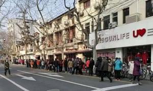 A long queue outside Three Gun Life, a clothing shop in Shanghai