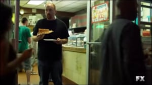 Louis CK exits the subway and heads to Ben's Pizzeria in Greenwich Village...