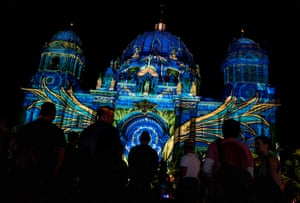 Berlin, Germany: Visitors gather outside the Berlin Cathedral, illuminated as part of the yearly Festival of Lights, an open-air light art gallery with over 90 works of art in 86 locations throughout the city