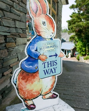 A sign, in the shape of Peter Rabbit, points the way to the World of Beatrix Potter attraction in Windermere, Lake District, UK