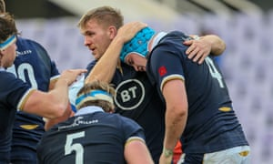 Scott Cummings of Scotland celebrates after scoring a try.