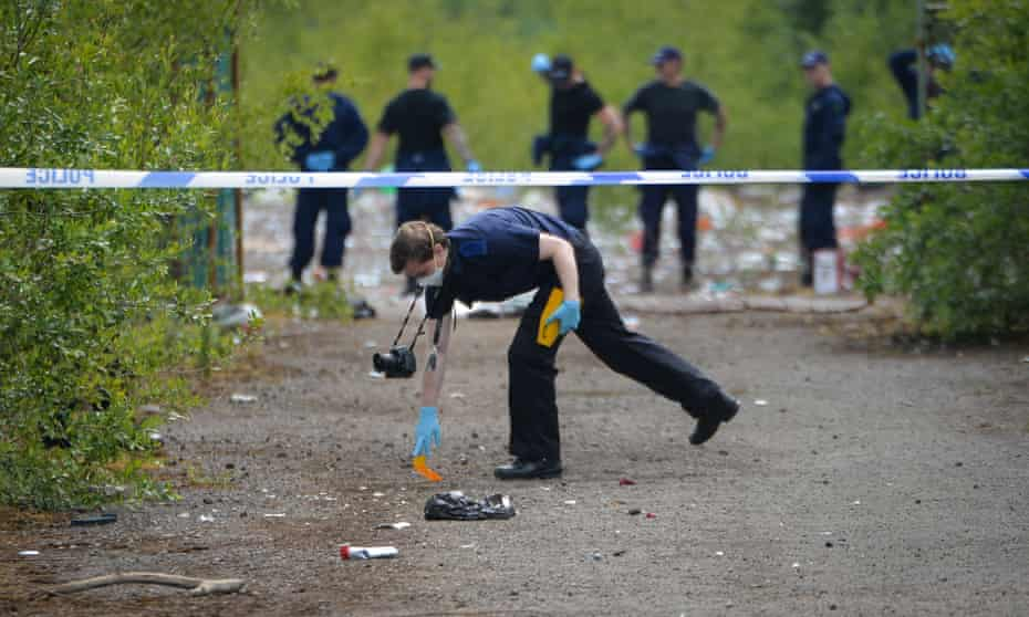 Police at the scene in Carrington, Trafford, where 2,000 people had gathered