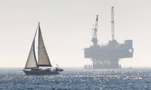 An oil drilling rig is off the Pacific Ocean coastline: Seal Beach, California.