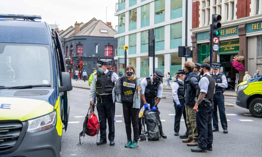 Protesters are arrested by police at the junction of Tower Bridge Road and Tooley Street, London.