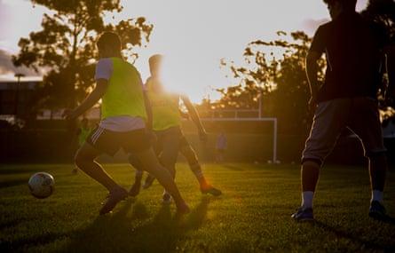 Teenage asylum seekers play football in Granville Park, in western Sydney.