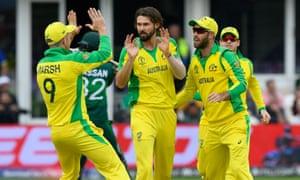 Joy amongst the Australian crew as Kane Richardson celebrates taking the wicket of Hassan Ali of Pakistan.