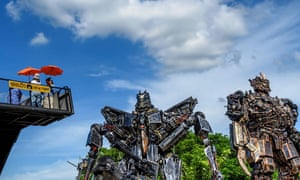Ang Thong, Thailand: Tourists take photos of life-sized sculptures of Transformers characters.