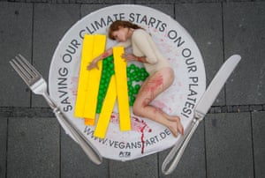 Animal rights organisation Peta's climate message in Munich, Germany, aims to raise awareness of the link between climate change and the consumption of meat.
