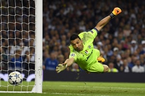 Gianluigi Buffon of Juventus dives but fails to stop Casemiro of Real Madrid shot from going in.
