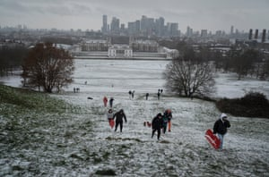 People enjoy the snow at Greenwich Park in London