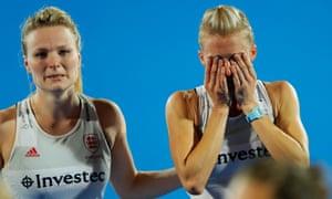 Hollie Pearne-Webb, left, consoles her captain Alex Danson after England's defeat.