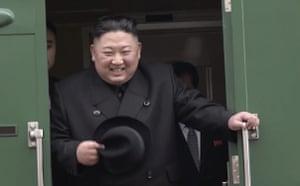 Kim smiles as he arrives at a railway station in the Russian settlement of Khasan