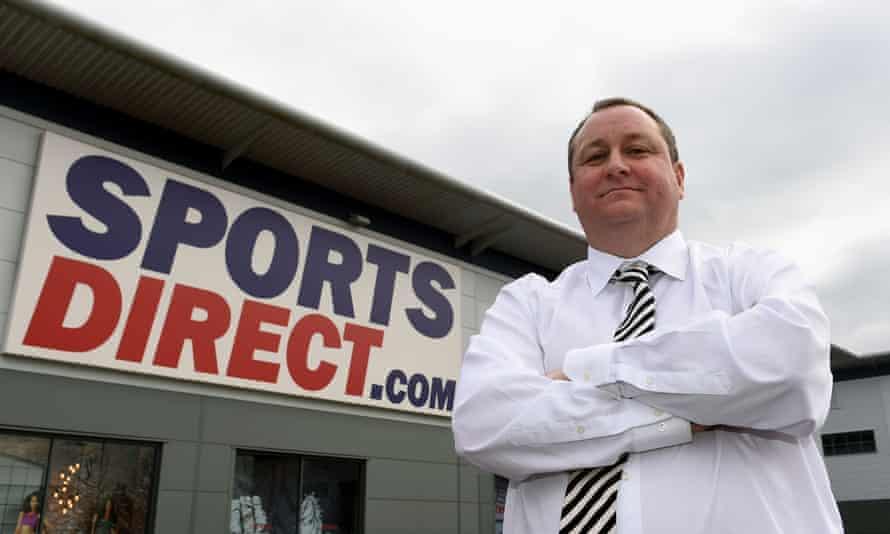Mike Ashley outside a Sports Direct shop