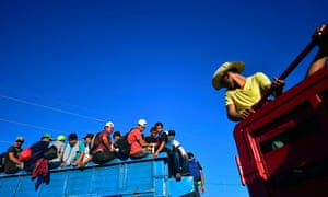 Thousands of mostly Honduran migrants crowded into the Mexican border city of Tapachula over the weekend after trekking on foot from the Guatemalan border.