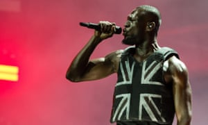Stormzy wearing the Banksy-designed, stab-proof vest onstage at Glastonbury