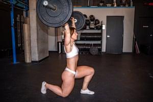Bodybuilder and arm wrestling champion Kortney Olson lifting weights.
