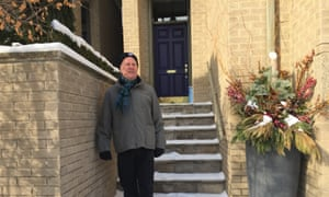 Vian Ewart stands by a planter that police investigated at his town house in Toronto, Canada. McArthur was his landscaper.