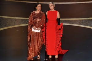 Maya Rudolph and Kristen Wiig being funny – and presenting the award for production design.