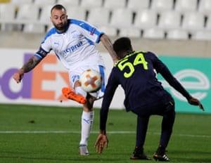 Apollon Limassol's Fotis Papoulis shoots past Everton's Beni Baningime.