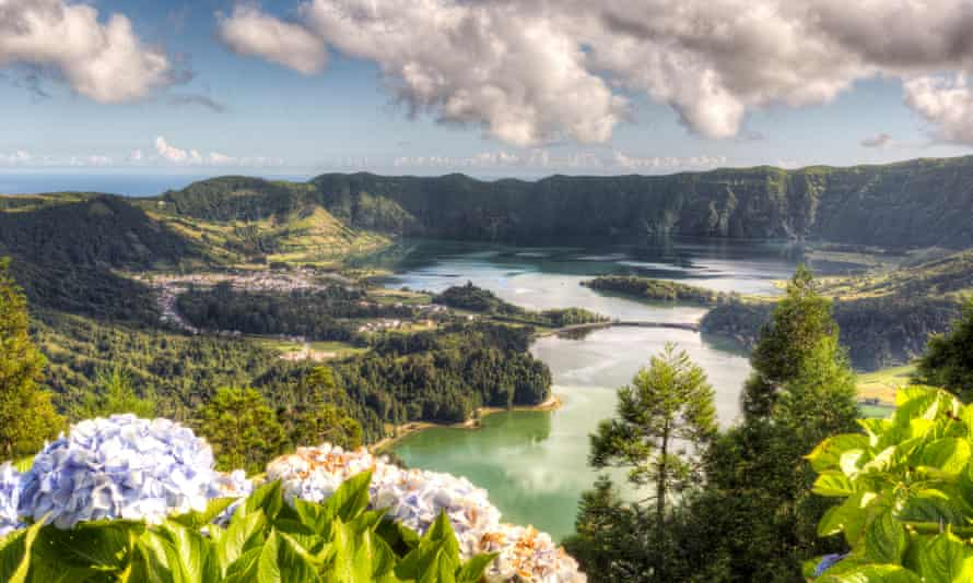 Landscape view of an Azores' lake and mountain on a sunny day.