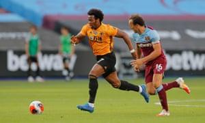 Wolves' Adama Traoré outpaces West Ham's Mark Noble.