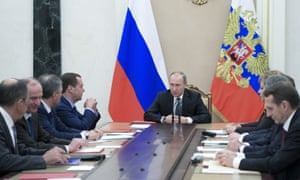 Vladimir Putin chairs a security council meeting in the Kremlin on Friday.