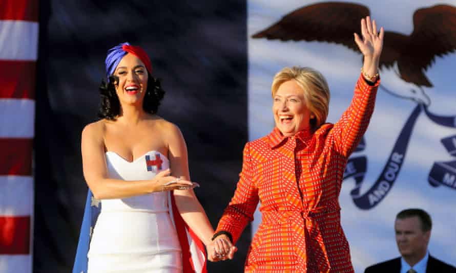 Singer Katy Perry and Democratic presidential candidate Hillary Clinton wave to supporters outside the Iowa Events Center in October 2015.