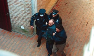 Former dictator Jorge Videla is escorted by police into the San Isidro court building in 1998. He died in 2013.