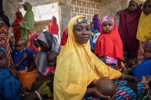 Asma Isheru holds her youngest child, one-month-old Fatima