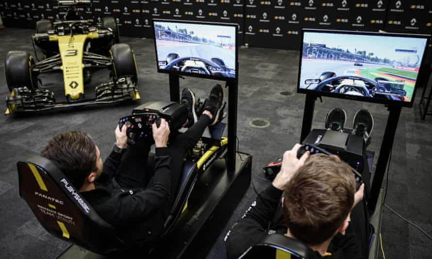 Renault Vitality's Jarno Opmeer (right) plays the official F1 video game alongside Renault Sport Academy driver Max Fewtrell.