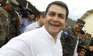 President Juan Orlando Hernández smiles during the inauguration of a military facility in Tegucigalpa on 3 June 2015.