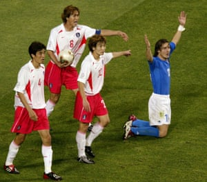 The South Korea players point to Francesco Totti after the Italy striker fell in the penalty box. He duly received a second yellow card for diving.