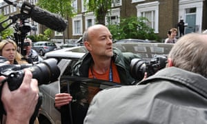 Dominic Cummings leaves his home in London on Sunday following allegations he broke coronavirus lockdown rules by travelling across the country in March