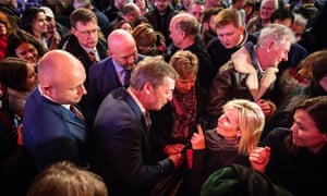 Nigel Farage is mobbed by supporters at the Westminster rally
