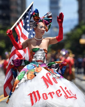 Khuong Lam wears a Donald Trump-themed protest dress while marching