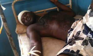 One of the claimants in the case receives treatment after protests turned violent at the African Minerals iron ore mine near Bumbuna, Sierra Leone, in 2012.