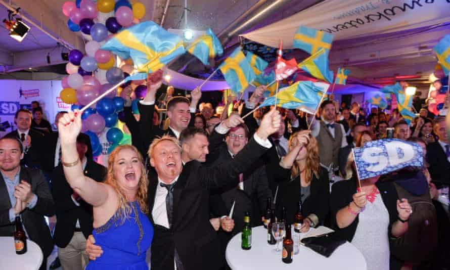 Supporters of the far-right Sweden Democrats wave Swedish flags and celebrate in Stockholm after the party made major gains at the last general election in 2014