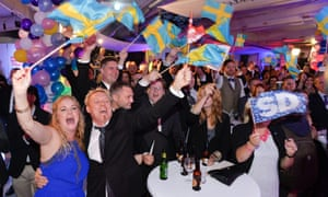 Members of the far-right, anti-immigration Sweden Democrats celebrate major gains in 2014 elections.