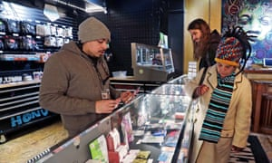 A 'cannabis consultant' talks customers through the edible marijuana products in a Seattle pot shop.
