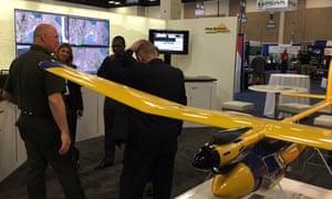 A Border Patrol agent visits a drone exhibit at the San Antonio border security expo