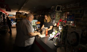 Tom Hyde, left, buys a can of fuel for his Coleman camp stove from Kim Scheffer at a Village True Value Hardware store in Santa Rosa.