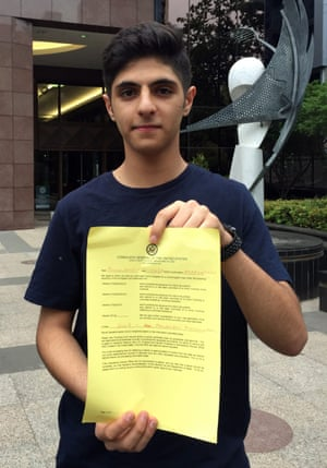 Australian schoolboy Pouya Ghadirian shows the document declining his visa request outside the US consulate in Melbourne on Monday.