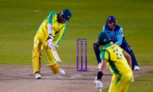Australia's Mitchell Starc (left) hits the ball for six runs in the final over.