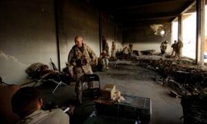 McMaster greets troops resting in an old maintenance building in Babil province, Iraq, in April 2005.