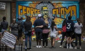 A mural of George Floyd near the spot where he died while in police custody in Minneapolis.